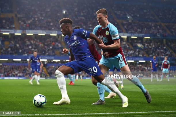 Callum HudsonOdoi of Chelsea holds off Ashley Barnes of Burnley during the Premier League match between Chelsea FC and Burnley FC at Stamford Bridge...