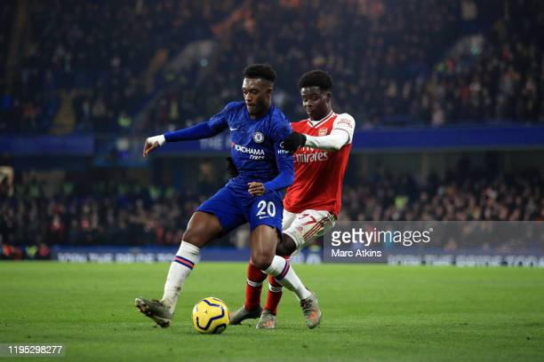 Callum HudsonOdoi of Chelsea in action with Bukayo Sako of Arsenal during the Premier League match between Chelsea FC and Arsenal FC at Stamford...