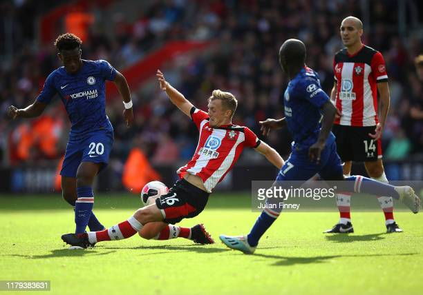 Callum HudsonOdoi of Chelsea is caught in the ankle by James WardProwse of Southampton during the Premier League match between Southampton FC and...