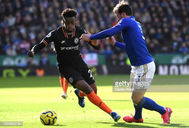Callum HudsonOdoi of Chelsea is challenged by Ben Chilwell of Leicester City during the Premier League match between Leicester City and Chelsea FC at...