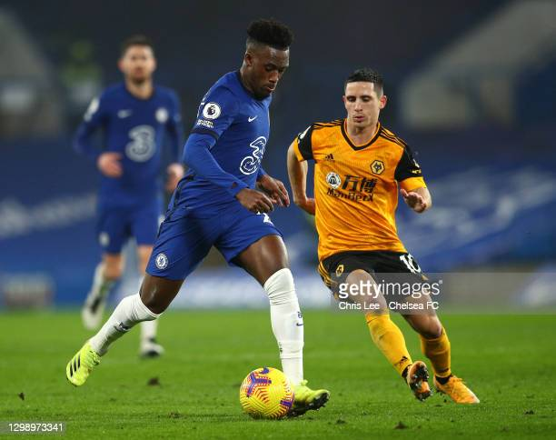 Callum Hudson-Odoi of Chelsea is closed down by Daniel Podence of Wolverhampton Wanderers during the Premier League match between Chelsea and...