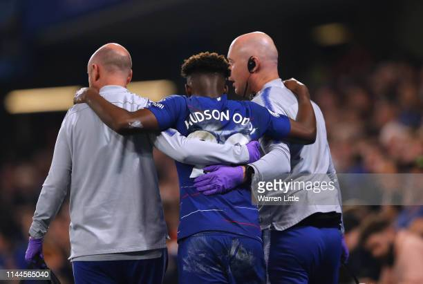 Callum HudsonOdoi of Chelsea is helped off the pitch after sustaining an injury during the Premier League match between Chelsea FC and Burnley FC at...