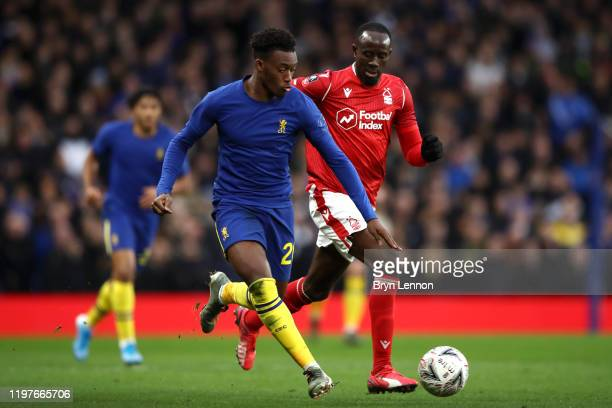Callum HudsonOdoi of Chelsea is put under pressure by Albert Adomah of Nottingham Forest during the FA Cup Third Round match between Chelsea and...