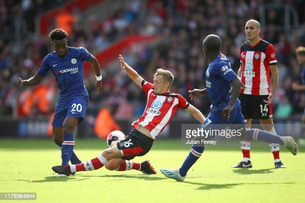Callum HudsonOdoi of Chelsea is tackled by James WardProwse of Southampton during the Premier League match between Southampton FC and Chelsea FC at...