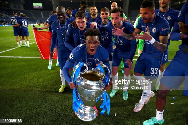 Callum Hudson-Odoi of Chelsea lifts the UEFA Champions League Trophy during the UEFA Champions League Final between Manchester City and Chelsea FC at...