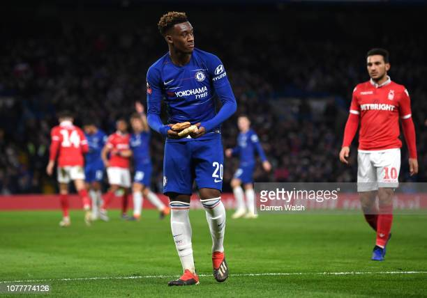 Callum HudsonOdoi of Chelsea picks up a burger and takes it to the side of the pitch during the FA Cup Third Round match between Chelsea and...