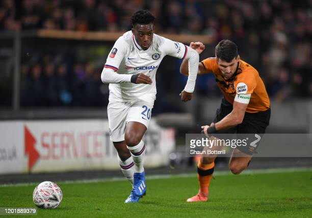 Callum HudsonOdoi of Chelsea runs from Eric Lichaj of Hull City during the FA Cup Fourth Round match between Hull City FC and Chelsea FC at KCOM...