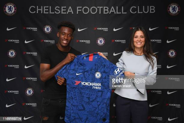 Callum HudsonOdoi of Chelsea signs a new 5 year contract along side Director Marina Granovskaia at Stamford Bridge on September 19 2019 in London...