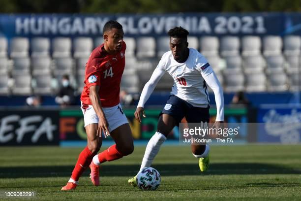 Callum Hudson-Odoi of England battles for possession with Dan Ndoye of Switzerland during the 2021 UEFA European Under-21 Championship Group D match...
