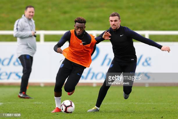 Callum HudsonOdoi of England in action with Jordan Henderson of England during an England training session during an England Media Access day at St...