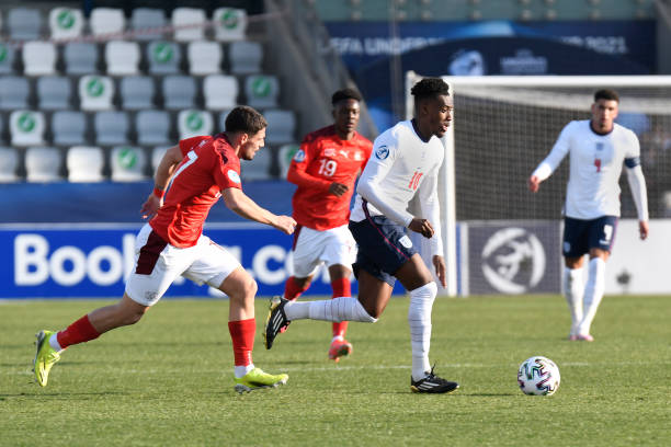 Callum Hudson-Odoi of England runs with the ball past Kastriot Imeri of Switzerland during the 2021 UEFA European Under-21 Championship Group D match...