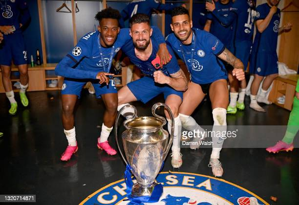Callum Hudson-Odoi, Olivier Giroud and Emerson Palmieri of Chelsea celebrate in the dressing room with the Champions League Trophy following their...