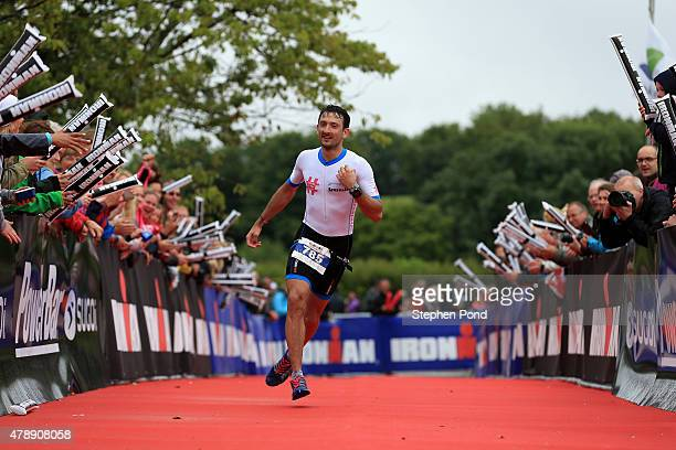 Callum Hughes of Great Britain reacts as he finishes the Ironman 703 Exmoor event on June 28 2015 in Exmoor National Park England