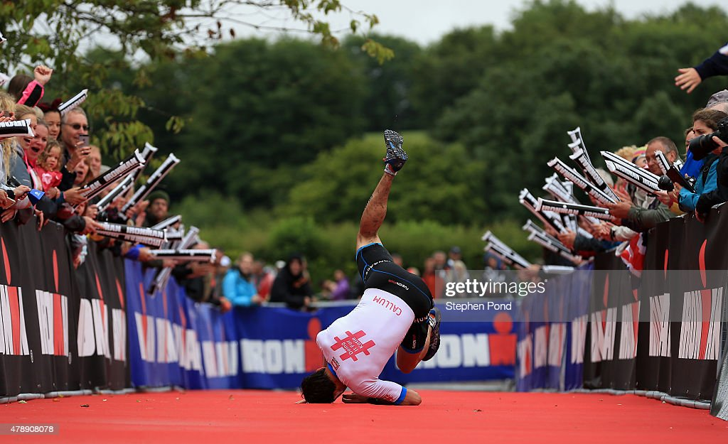 Callum Hughes of Great Britain reacts as he finishes the Ironman 70.3 Exmoor event on June 28, 2015 in Exmoor National Park, England.