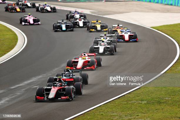 Callum Ilott of Great Britain and UNI-Virtuosi Racing drives leads the field at the start during the feature race for the Formula 2 Championship at...