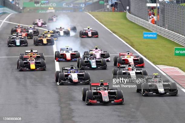 Callum Ilott of Great Britain and UNI-Virtuosi Racing leads Luca Ghiotto of Italy and Hitech Grand Prix and the rest of the field at the start during...