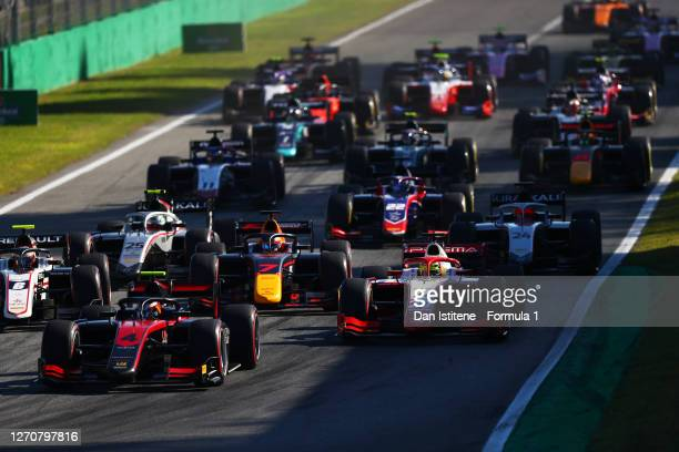 Callum Ilott of Great Britain and UNI-Virtuosi Racing leads Mick Schumacher of Germany and Prema Racing drives and the rest of the field at the start...