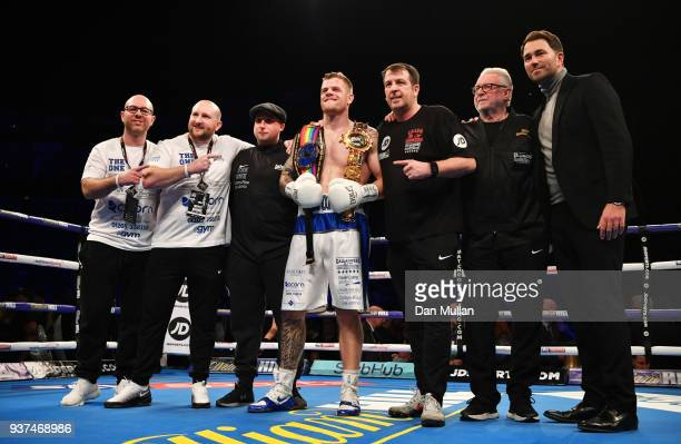 Callum Johnson celebrates victory over Frank Buglioni with trainer Joe Gallagher promoter Eddie Hearn and his team after British and Commonwealth...