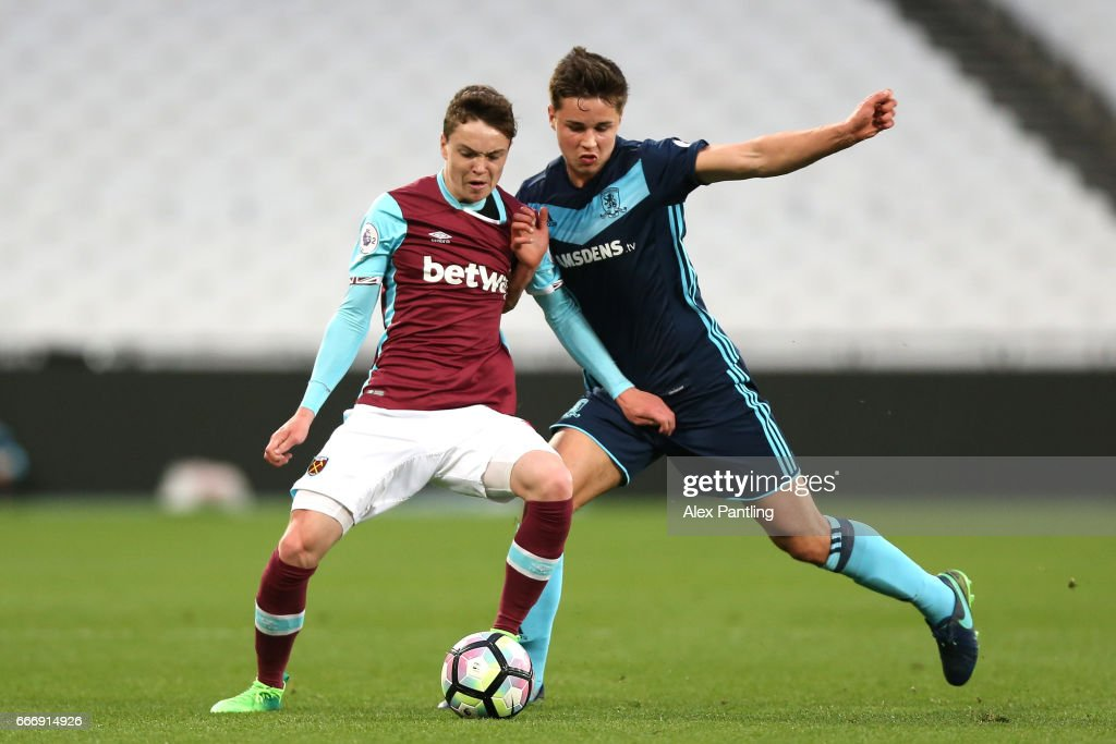 Callum Johnson of Middlesbrough and Alfie Lewis of West Ham United in action during the Premier League 2 match between West Ham United and Middlesbrough at London Stadium on April 10, 2017 in Stratford, England.