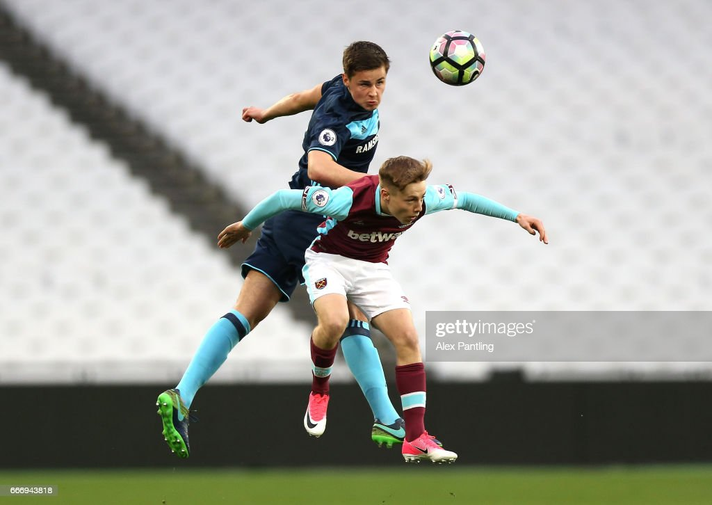 Callum Johnson of Middlesbrough and Dan Kemp of West Ham United in action during the Premier League 2 match between West Ham United and Middlesbrough at London Stadium on April 10, 2017 in Stratford, England.