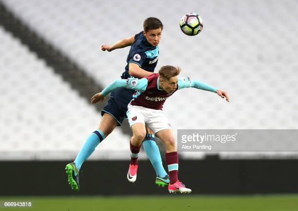 Callum Johnson of Middlesbrough and Dan Kemp of West Ham United in action during the Premier League 2 match between West Ham United and Middlesbrough...