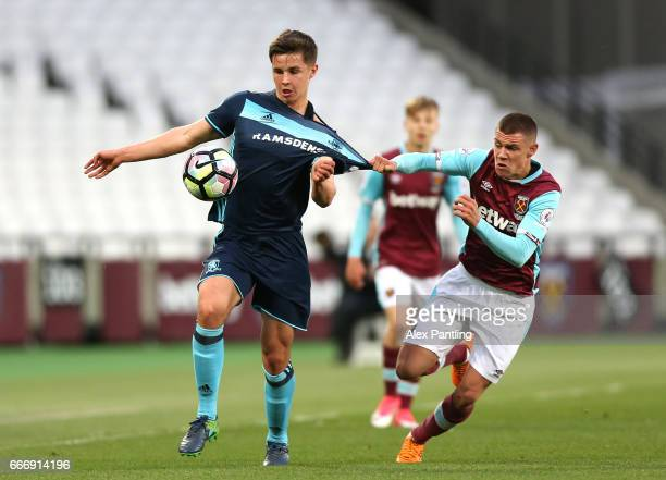 Callum Johnson of Middlesbrough and Sam Westley of West Ham United in action during the Premier League 2 match between West Ham United and...