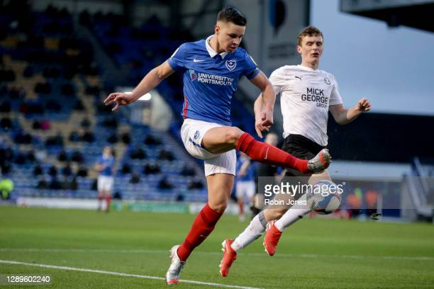 Callum Johnson of Portsmouth FC and Ethan Hamilton of Peterborough United during the Sky Bet League One match between Portsmouth and Peterborough...