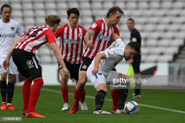 Callum Johnson of Portsmouth is challenged during the Sky Bet League 1 match between Sunderland and Portsmouth at the Stadium Of Light Sunderland on...