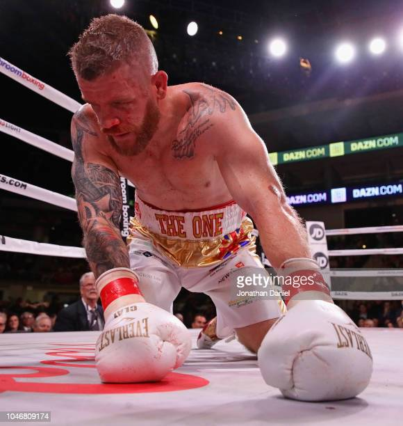 Callum Johnson tries to get up after being knocked down by Artur Beterbiev during a IBF World Light-Heavyweight title fight at Wintrust Arena on...
