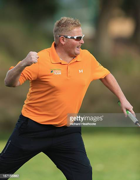 Callum Macaulay of Scotland celebrates a birdie putt from off the 18th green to secure his card for next season during the final round of the...