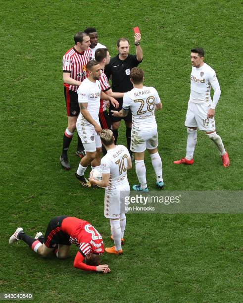Callum Macmanaman of Sunderland lies injured as Gaetano Berardi of Leeds is sent off during the Sky Bet Championship match between Leeds United and...