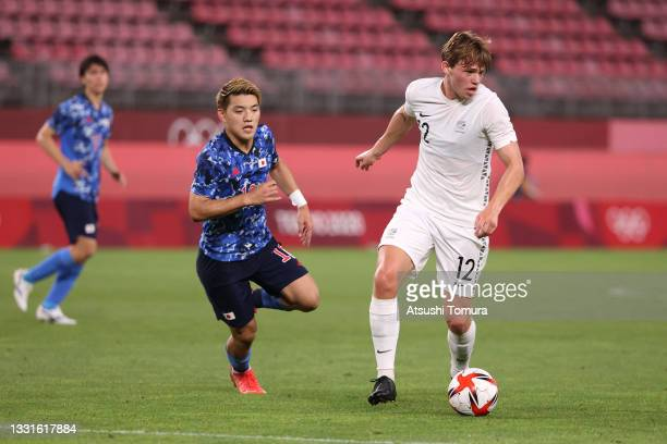 Callum McCowatt of Team New Zealand in possession whilst under pressure from Ritsu Doan of Team Japan during the Men's Quarter Final match between...