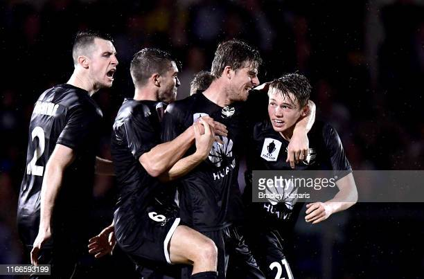 Callum McCowatt of the Phoenix celebrates scoring a goal during the FFA Cup Round of 32 match between the Brisbane Strikers and Wellington Phoenix at...