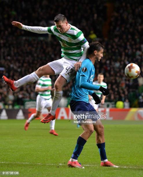 Callum McGregor of Celtic and Aleksandr Erokhin of Zenit St Petersburg clash during UEFA Europa League Round of 32 match between Celtic and Zenit St...