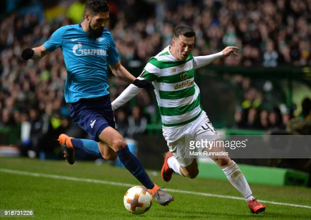 Callum McGregor of Celtic and Miha Mevlja of Zenit St Petersburg during UEFA Europa League Round of 32 match between Celtic and Zenit St Petersburg...