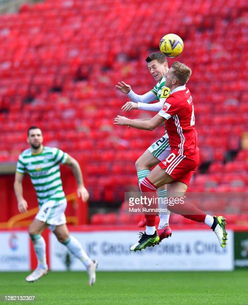 Callum McGregor of Celtic and Ross McCrorie of Aberdeen battle for a header during the Ladbrokes Scottish Premiership match between Aberdeen and...
