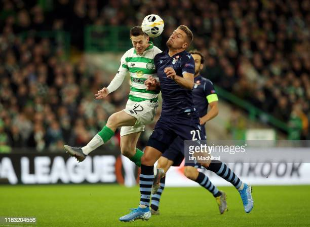 Callum McGregor of Celtic and Sergej MilinkovicSavic of Lazio compete for the ball during the UEFA Europa League group E match between Celtic FC and...
