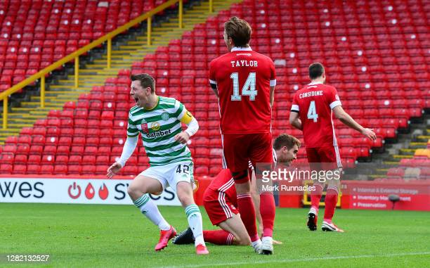 Callum McGregor of Celtic celebrates after scoring his team's first goal during the Ladbrokes Scottish Premiership match between Aberdeen and Celtic...