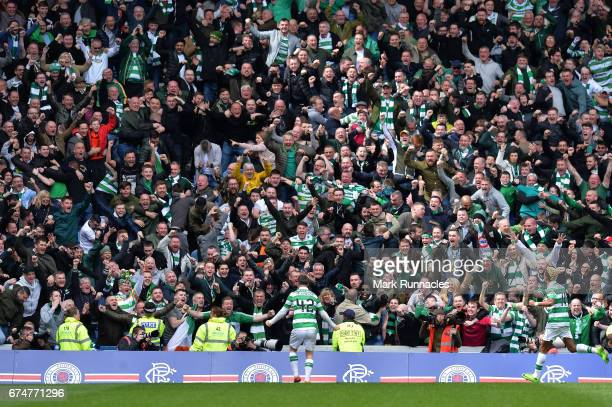 Callum McGregor of Celtic celebrates scoring his team's third goal in front of fans during the Ladbrokes Scottish Premiership match between Rangers...