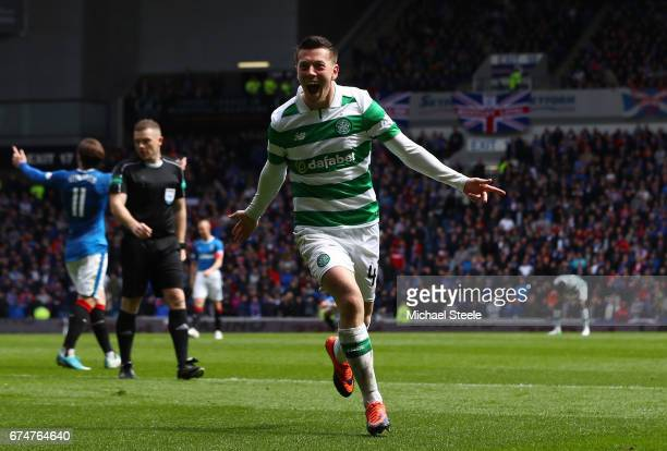 Callum McGregor of Celtic celebrates scoring his team's third goal during the Ladbrokes Scottish Premiership match between Rangers and Celtic at...