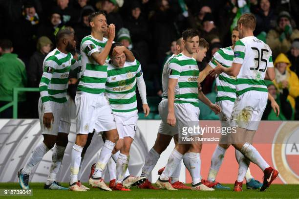 Callum McGregor of Celtic celebrates scoring the first Celtic goal with team mates during UEFA Europa League Round of 32 match between Celtic and...