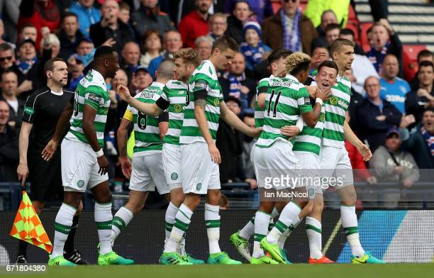 Callum McGregor of Celtic celebrates scoring the opening goal with his team mates during the Scottish Cup SemiFinal match between Celtic and Rangers...