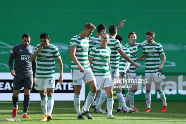 Callum McGregor of Celtic celebrates with teammates after scoring his sides first goal during the Ladbrokes Scottish Premiership match between Celtic...