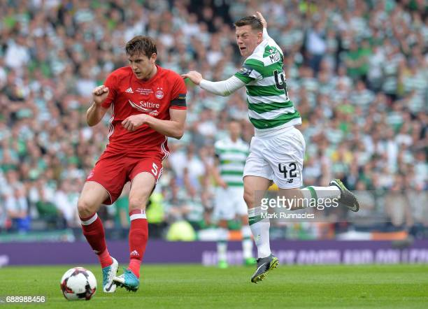 Callum McGregor of Celtic challenges Ash Taylor of Aberdeen for the ball during the William Hill Scottish Cup Final between Aberdeen and Celtic at...