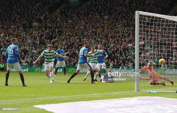 Callum McGregor of Celtic scores his sides fifth goal during the Scottish Premier League match between Celtic and Rangers at Celtic Park on April 29...