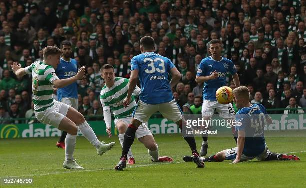 Callum McGregor of Celtic scores his team's fifth goal during the Scottish Premier League match between Celtic and Rangers at Celtic Park on April 29...