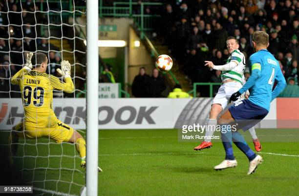 Callum McGregor of Celtic scores the first Celtic goal during UEFA Europa League Round of 32 match between Celtic and Zenit St Petersburg at the...