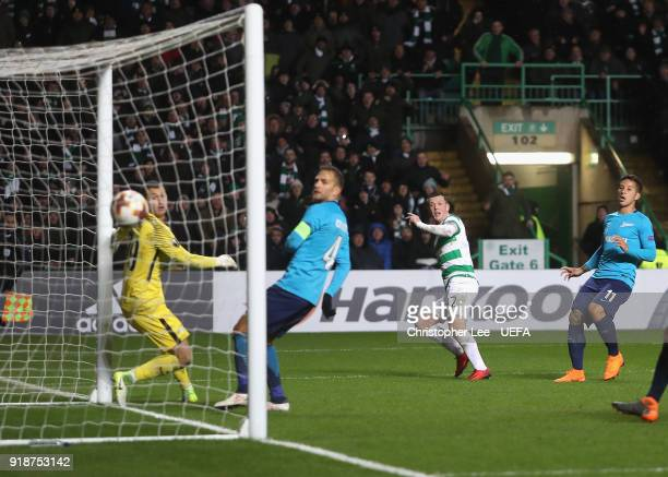 Callum McGregor of Celtic scores their winning goal during UEFA Europa League Round of 32 match between Celtic and Zenit St Petersburg at the Celtic...