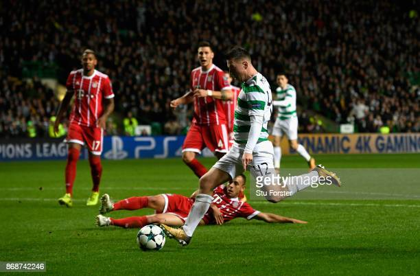 Callum McGregor of Celtic shoots and scores his side's first goal during the UEFA Champions League group B match between Celtic FC and Bayern...