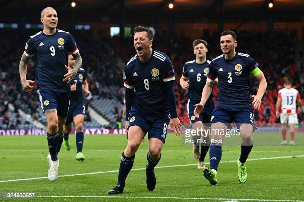 Callum McGregor of Scotland celebrates with teammates Lyndon Dykes and Andrew Robertson after scoring their side's first goal during the UEFA Euro...